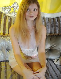 Girl posing on sofa